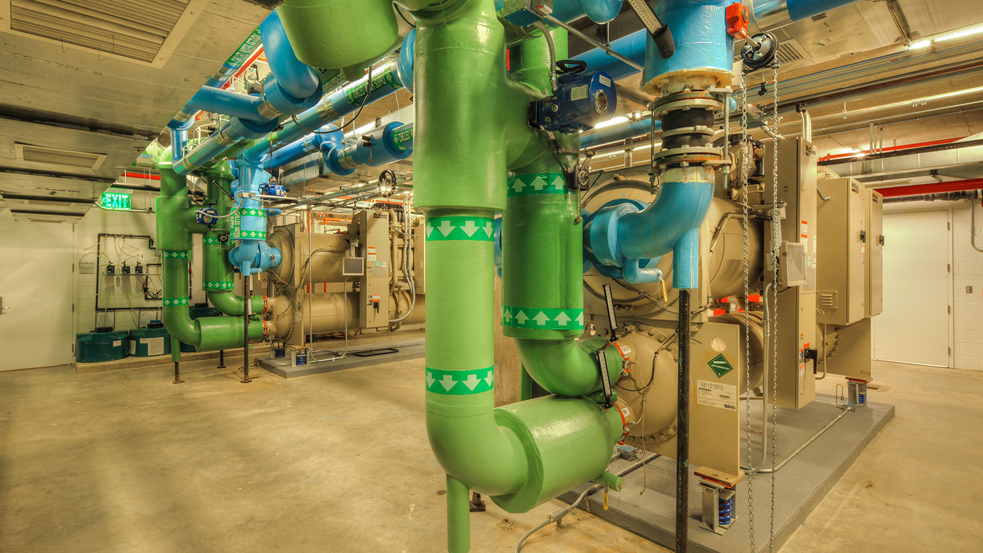 We designed a central chilled water system utilizing low temperature, wide temperature differentials, and variable primary flow. The result was a super high-efficient system that minimized the horsepower needed to deliver the tonnage.