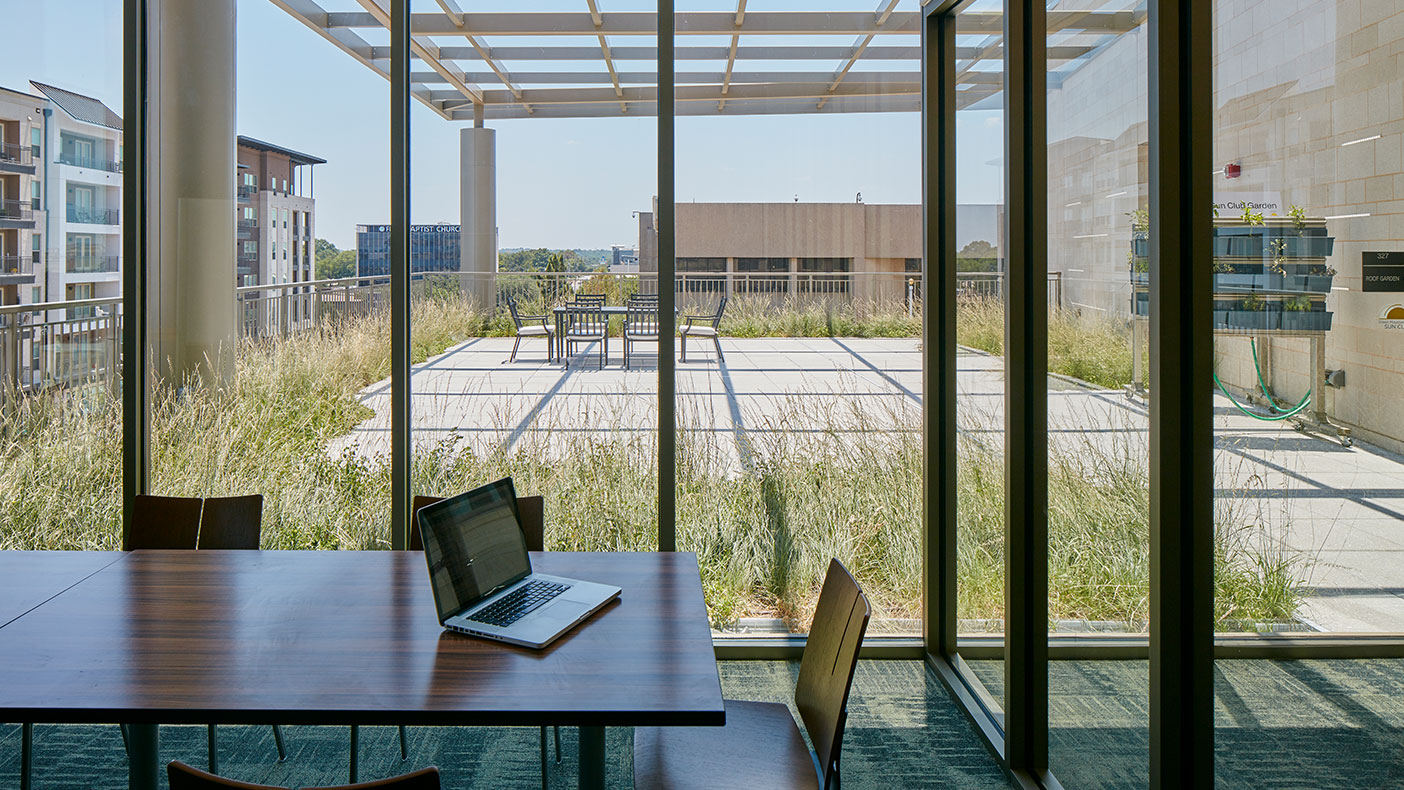 Two green roof gardens flank the second story and help the building meet its sustainable and efficiency goals.