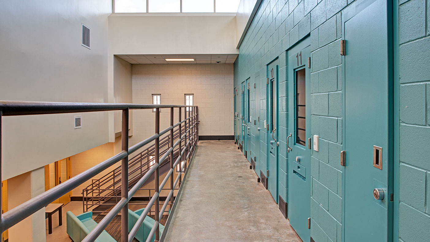 The center features five housing units designed for 12-14 juveniles in single rooms within a direct supervision setting.