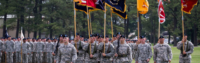Maj. Cullen Jones pictured front. Marches the unit colors forward for the 2nd Brigade Combat Team (STRIKE) Change of Command Ceremony, Fort Campbell, Kentucky, June 26, 2015.