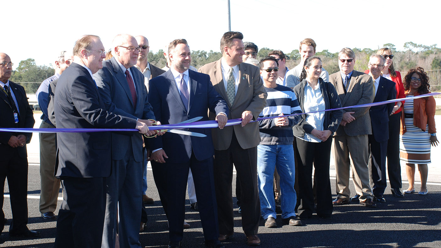 The ribbon cutting ceremony featured representatives from the Central Florida Expressway Authority, Greater Orlando Aviation Authority, and commissioners from Lake, Orange, and Osceola counties.