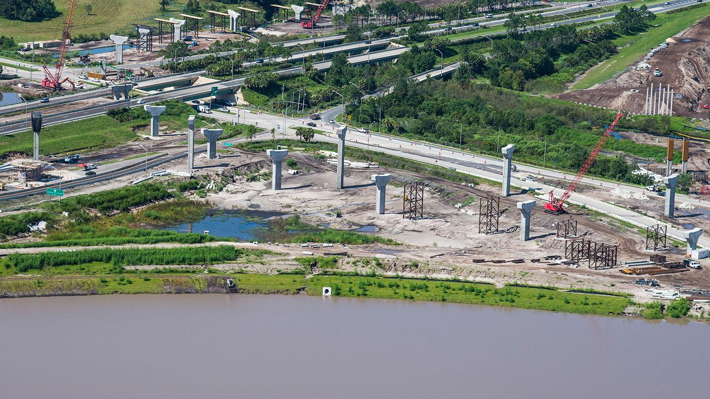 The first of their kind in Florida, the beams were precast, erected, and temporarily supported as lid slabs were placed.