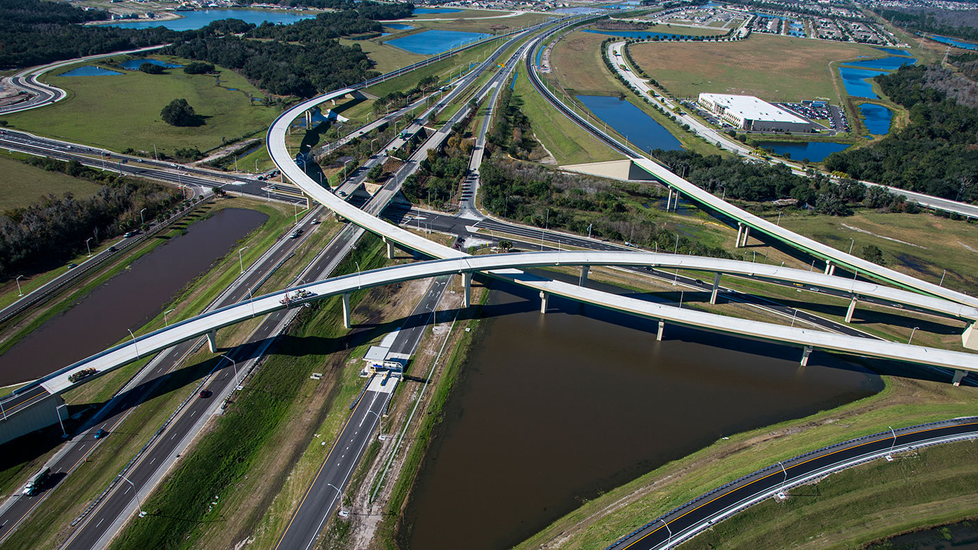 The post-tensioned precast curved concrete U-beam bridge design reduced initial construction costs and anticipated future maintenance needs.