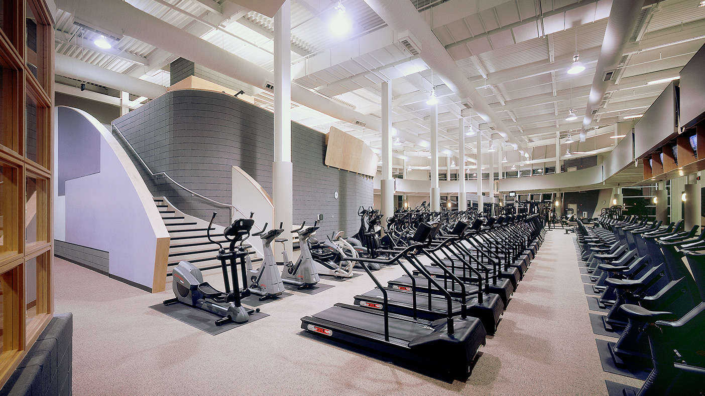 The first building within a planned park district development near Chicago, the fitness center is designed to anchor the development.