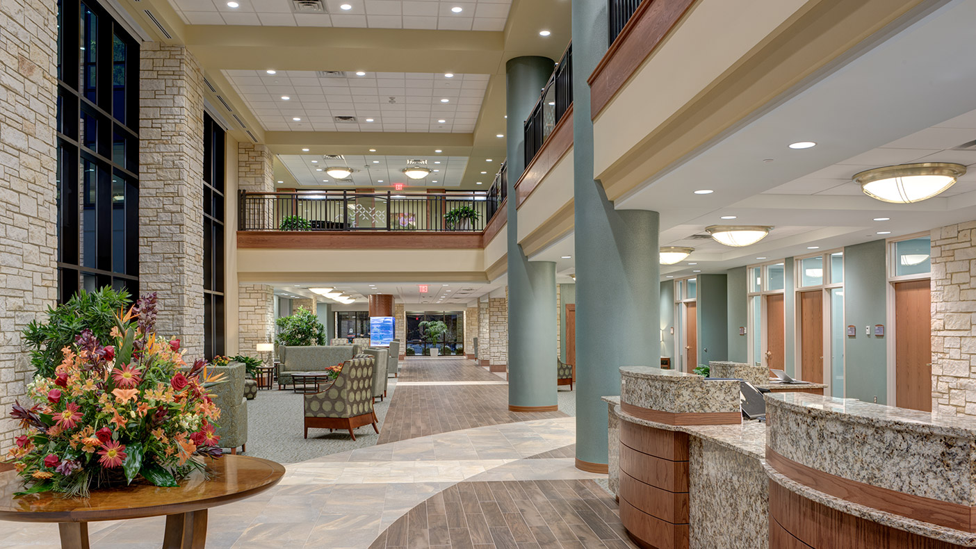 The expansive new two-story lobby provides a grand entrance and creates a central link between the new and existing areas.  It features intimate gathering spaces that are enhanced by natural light.