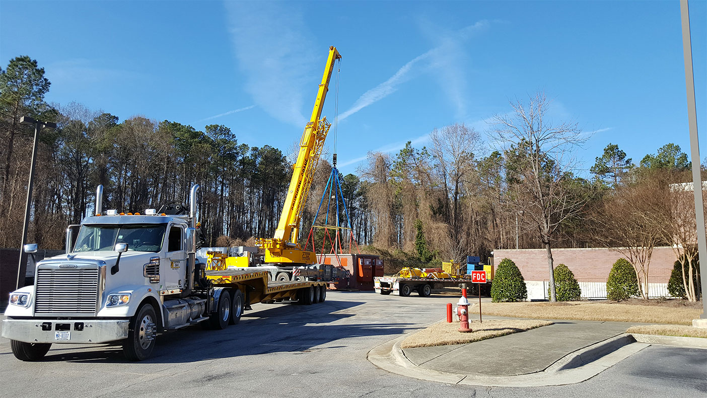 Construction services included cabling and pathway design from the existing neutral host DAS to the new shelter, and site/civil engineering for the site layout and foundation.