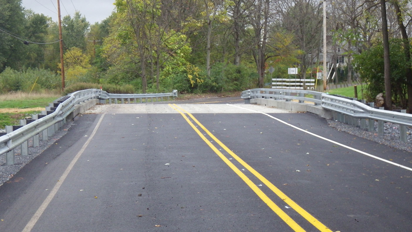 We designed a new bridge consisting of a single-span, adjacent box beam structure located on the existing alignment.