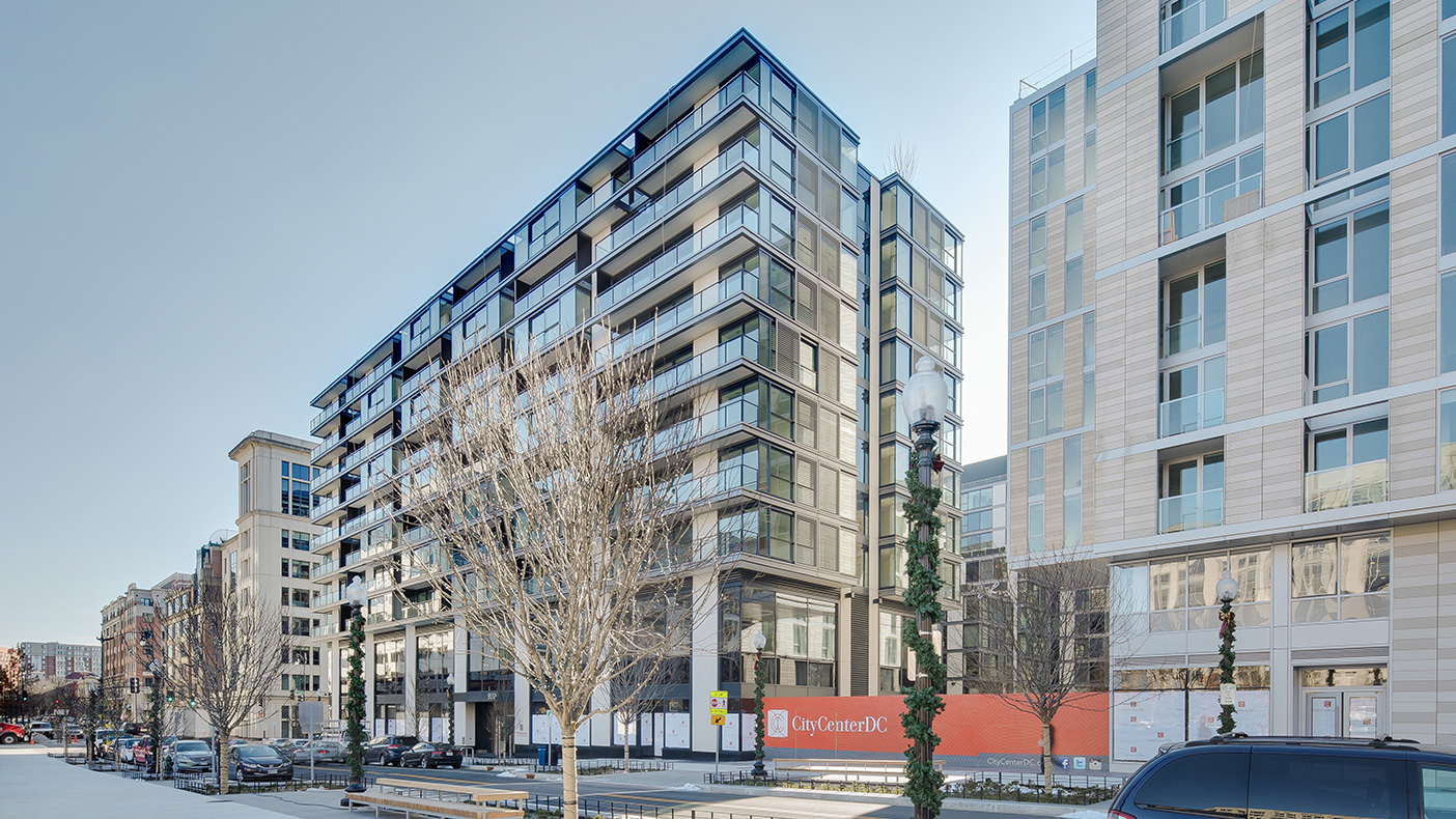 """The residential towers feature stepped massing and setbacks requiring mechanical systems to extend downward to the lower level and then offset and rise up in the """"full-height"""" area of the building."""