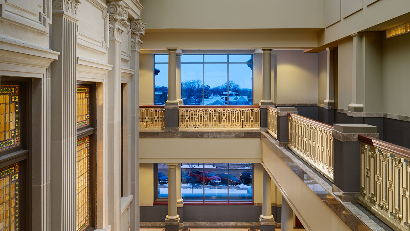 The addition provides shell space for future courtrooms along with a second floor guardrail that mimics the courthouse's original handrail design.