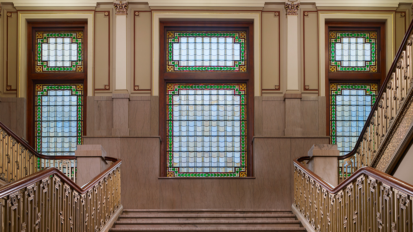 Design of the atrium allowed us to increase floor to ceiling heights, minimize covering of the existing façade, and bring in natural light to illuminate the existing stain glass windows.