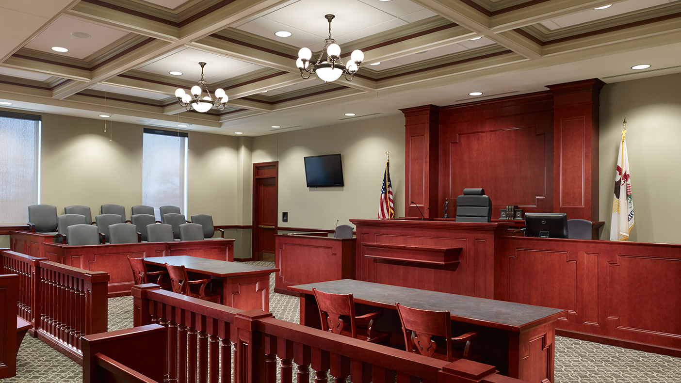The addition includes space for five new court rooms, judge's chambers, jury rooms, state's attorney office suite, public defender's office, holding cells, and a new secured entry for both staff and prisoner circulation separate from public space.