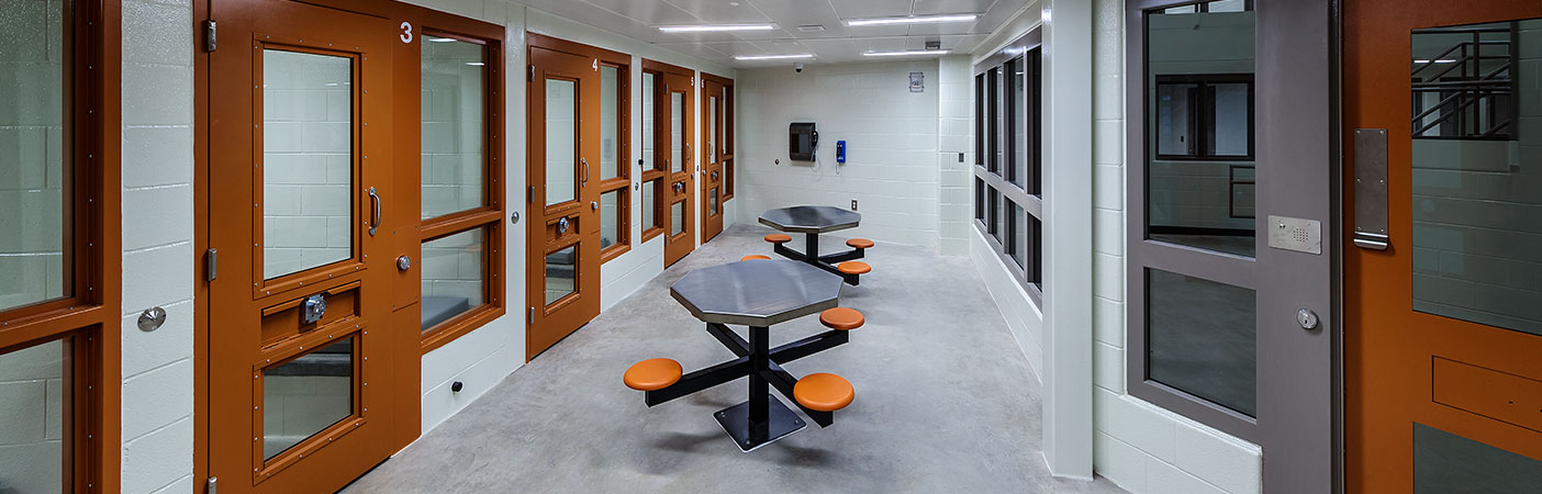 The holding cell dayrooms allow prisoners to be held temporarily, pending charge, trial, or sentencing.