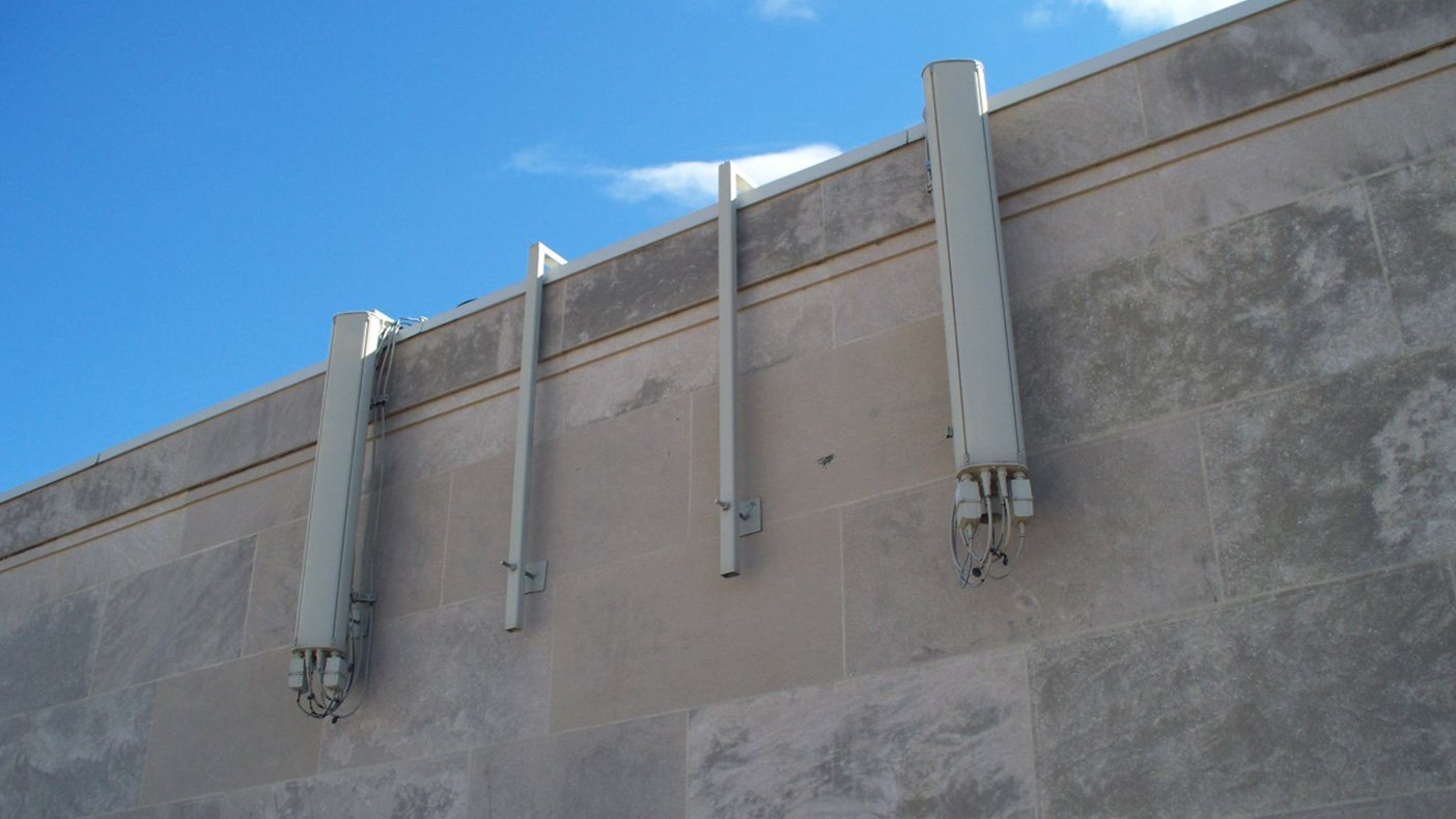 To keep the building's existing stone wall intact, we installed low-profile, non-penetrating antenna mounts to rest against the face of the building.