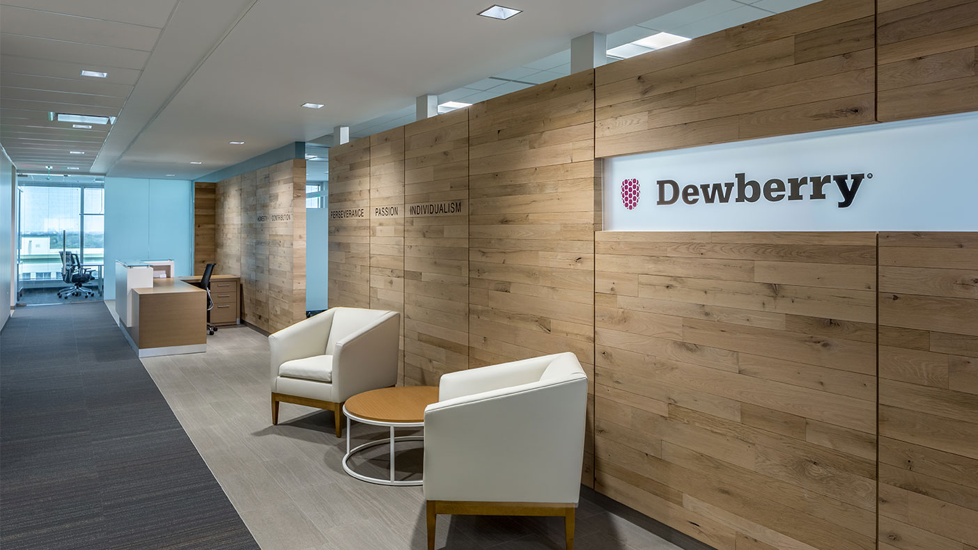 The entryway's wooden wall was recycled from an old fence and highlights our workplace principles.