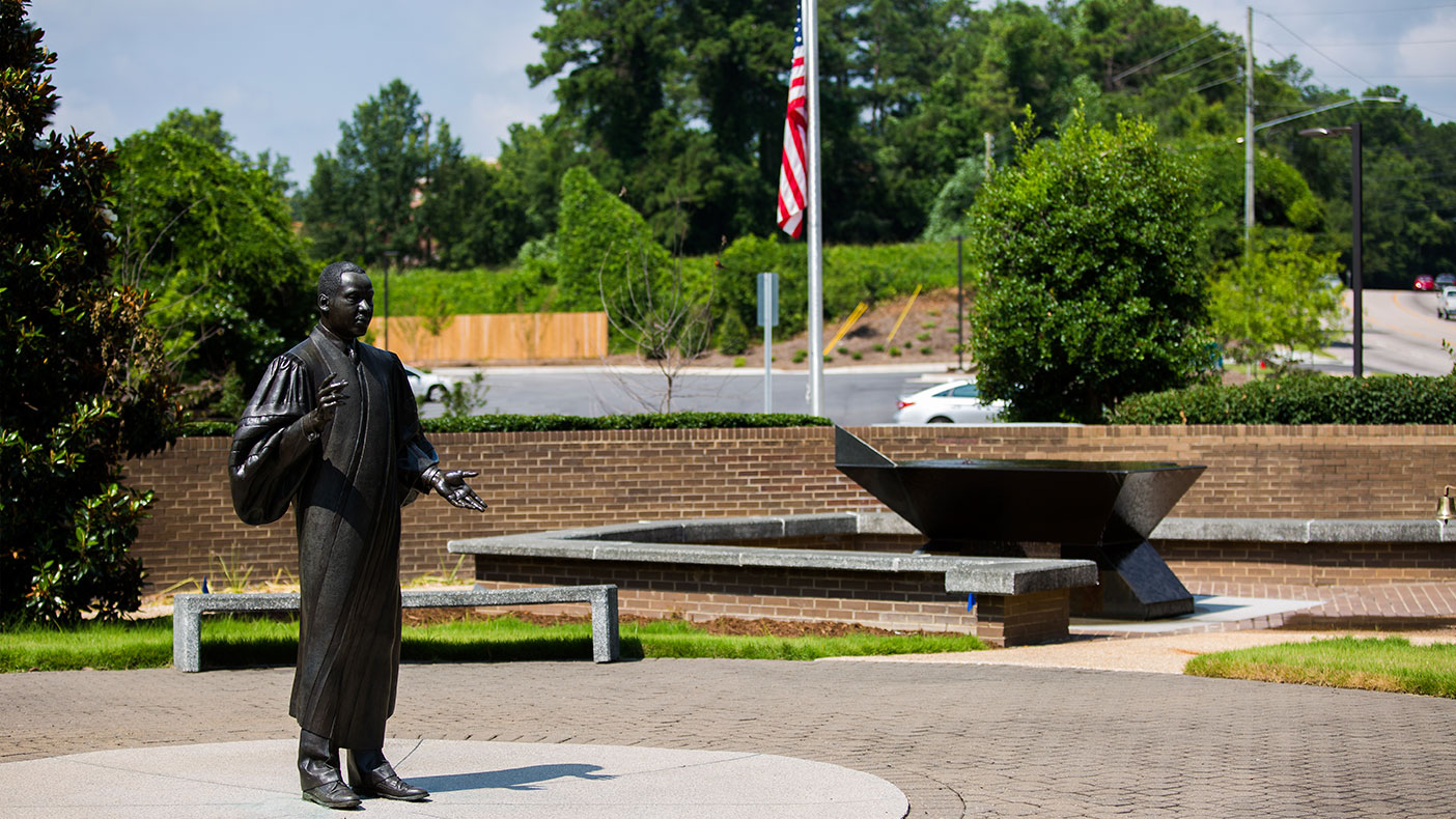 Dr. King's famous speech is inscribed on a large, stone fountain just east of his life-size statue.