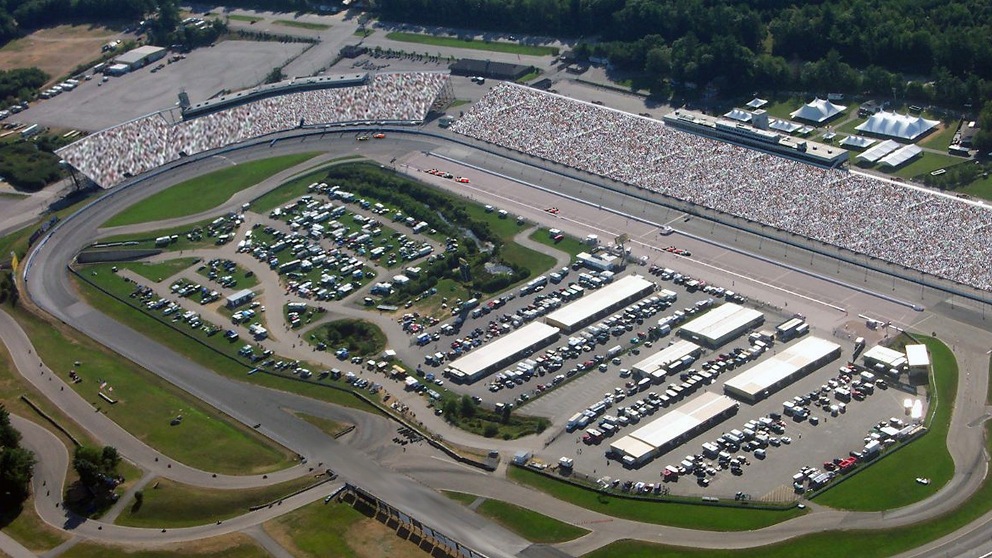 For the NASCAR Loudon Speedway, NH, we designed a steel frame to support panel, whip and dish antennas with an equipment shelter at grade. Power, telco and ground hookups were designed for five Cell-on-Wheels sites during race events.