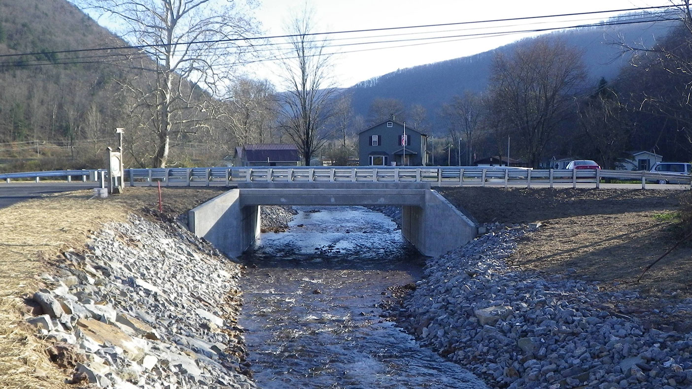We designed the new bridge, which consists of a 26-foot by eight-foot single-cell precast reinforced concrete box culvert at grade with precast end sections.