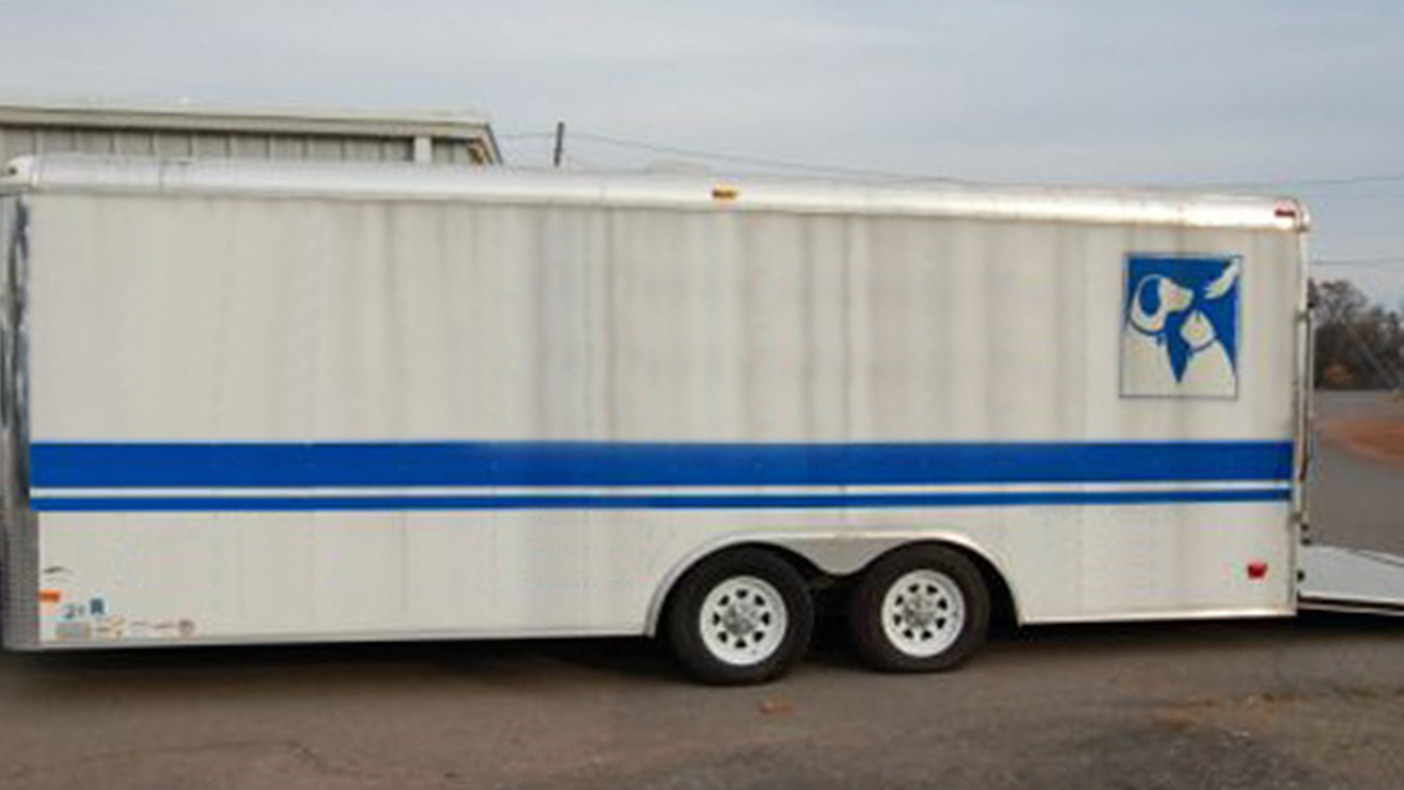 A pet shelter trailer stores all of the items necessary to operate an emergency pet shelter, including crates, food, registration tables, computers, and cameras.