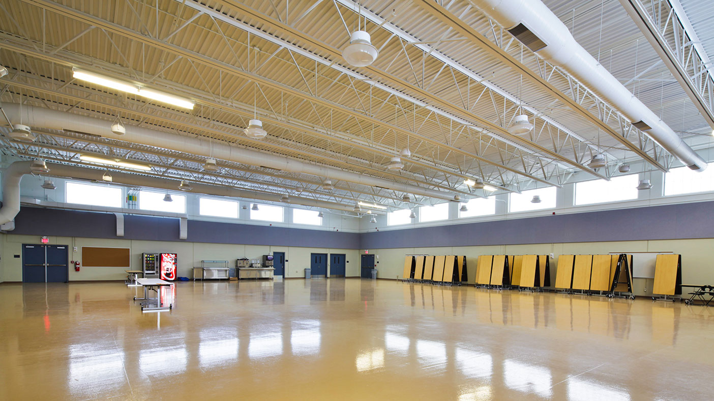 More than 8,000-SF of clear space for the assembly area serves multiple functions including indoor drills and dining.