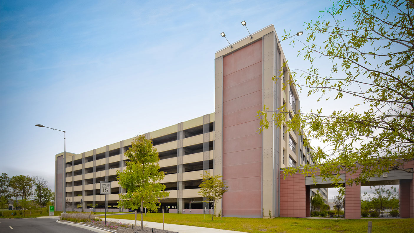 Two parking structures for 3,000+ vehicles and close to two miles of roadways were completed to support the community hospital.