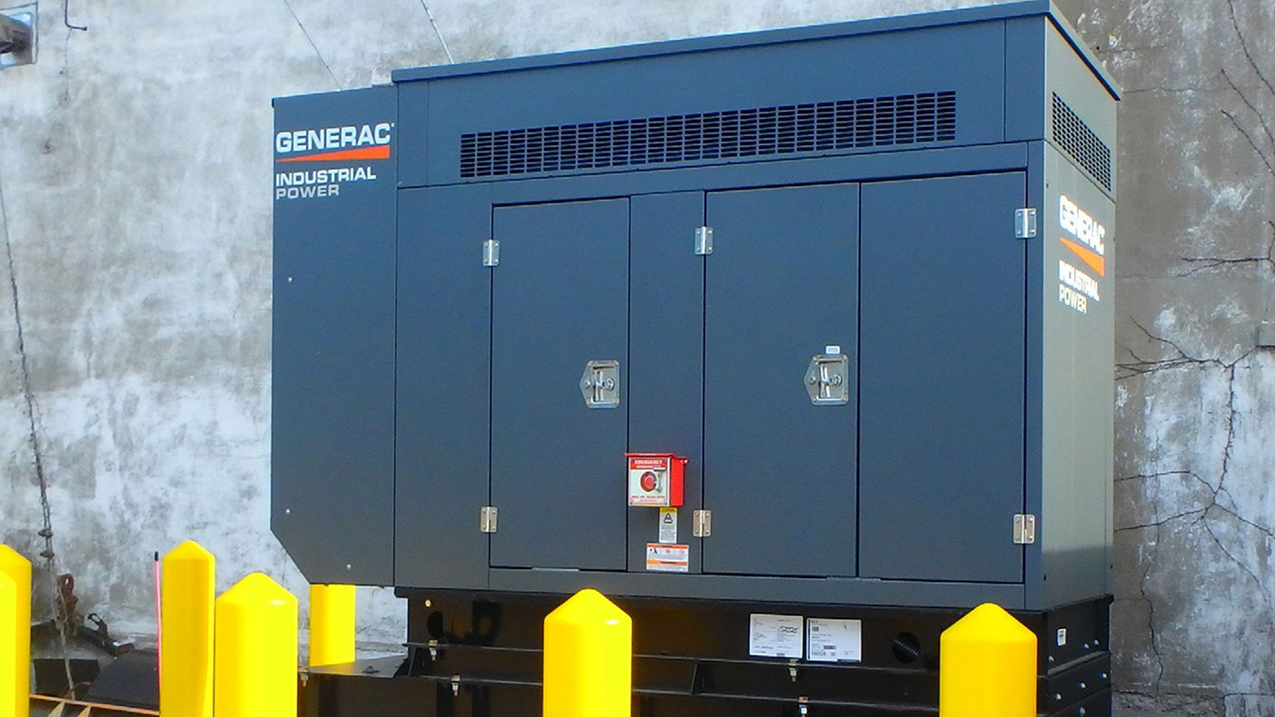 The town hall standby generator is on an outdoor sound attenuated enclosure on a concrete pad with a base mounted UL listed double wall diesel fuel storage tank.