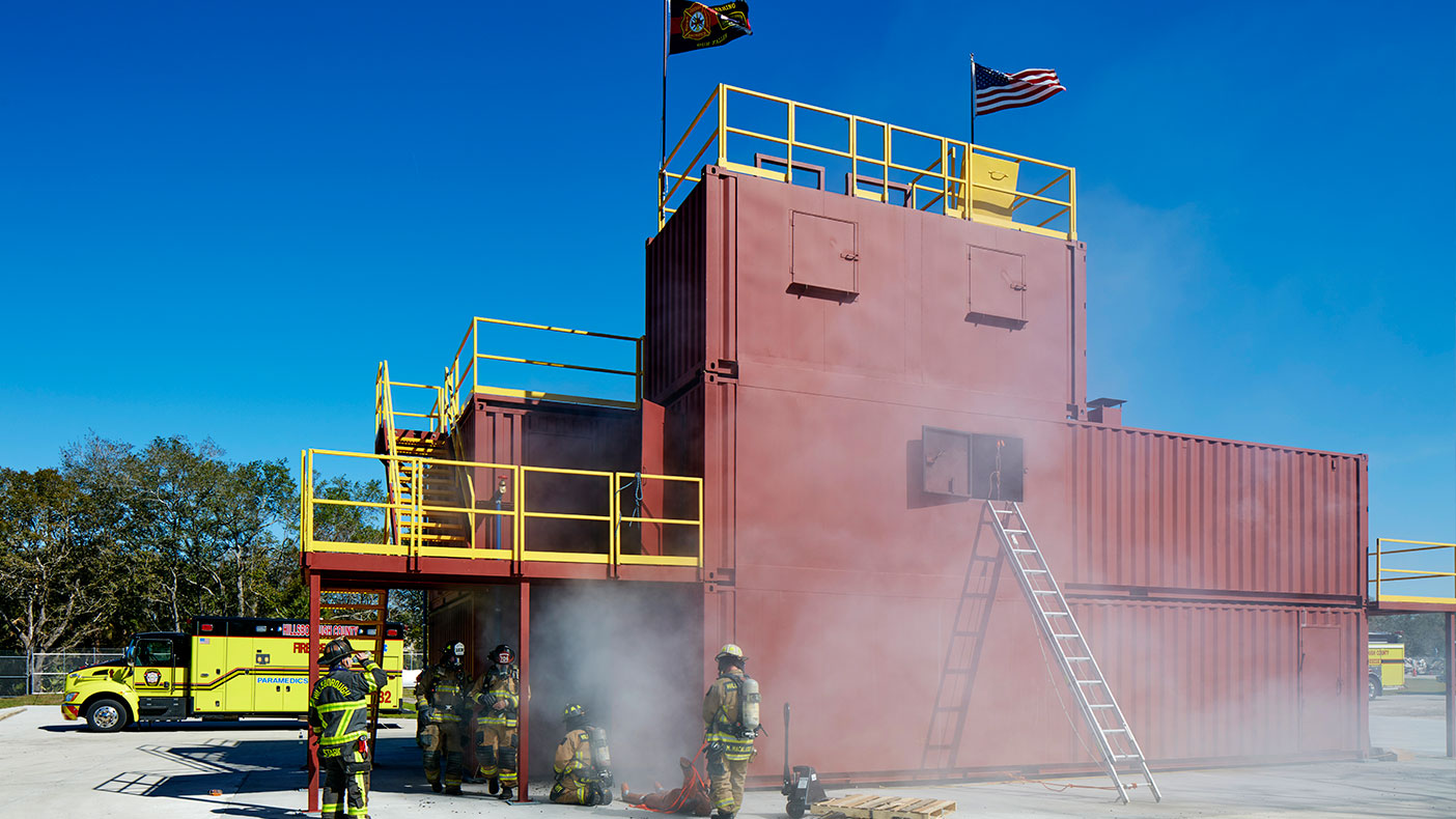 The exterior fire training area includes a burn building for live fire and rappel training.