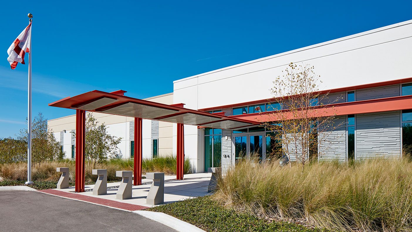 Drought-tolerant plants and natural Florida landscaping contribute to the buildings overall low maintenance and durable qualities.