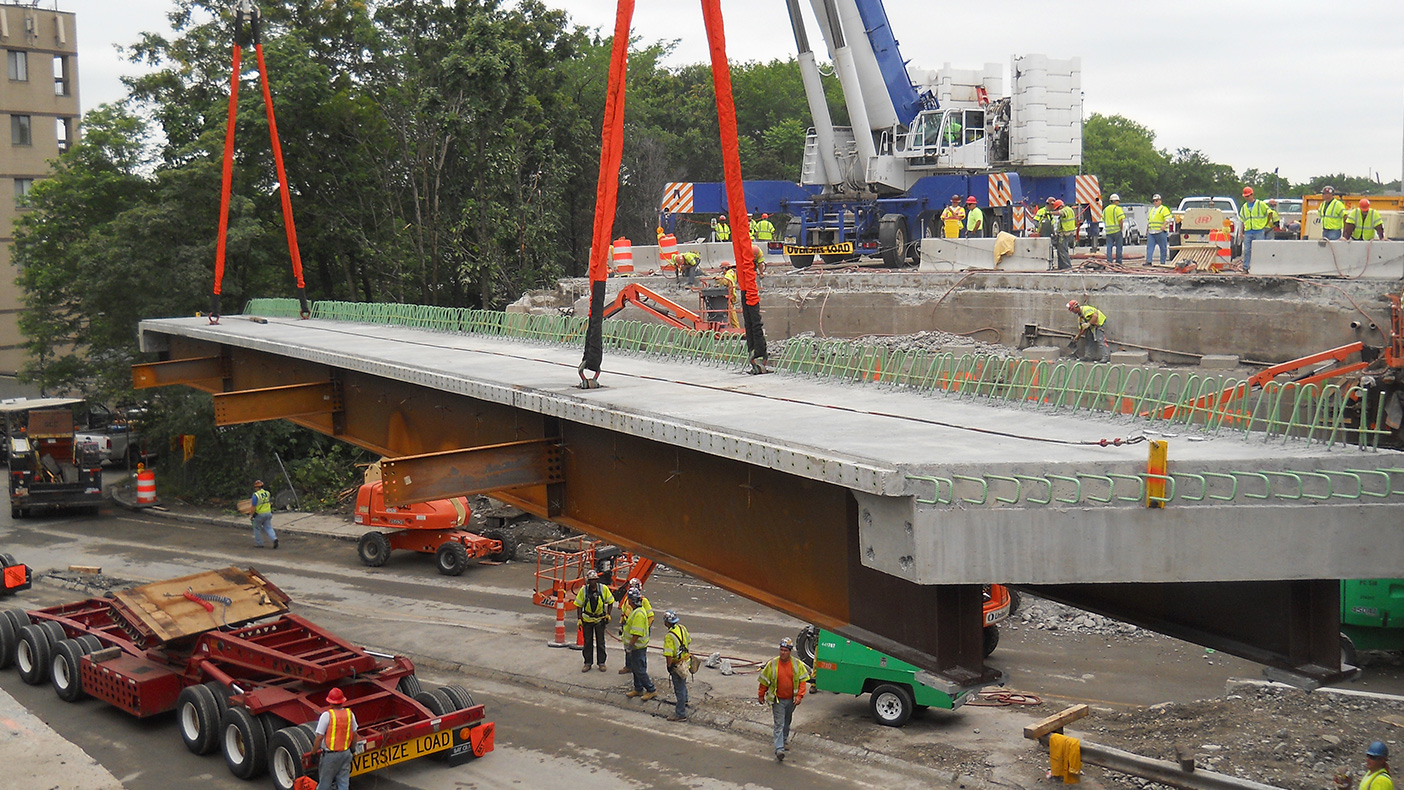 Modular units with two steel girders and a precast concrete deck were fabricated off-site to minimize the on-site work.