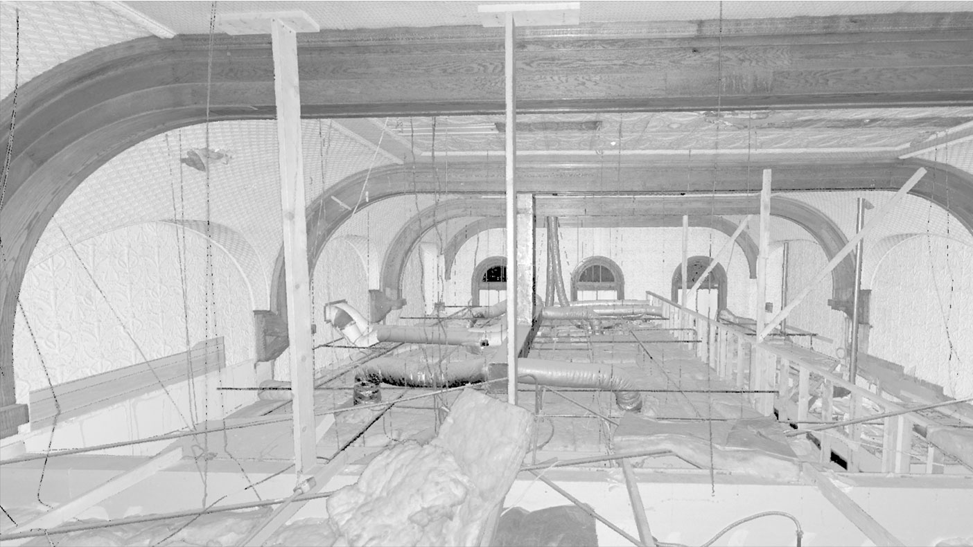 Laser scans revealed the original ceiling, still intact under the suspended acoustical ceilings, included arched windows in a soaring space.
