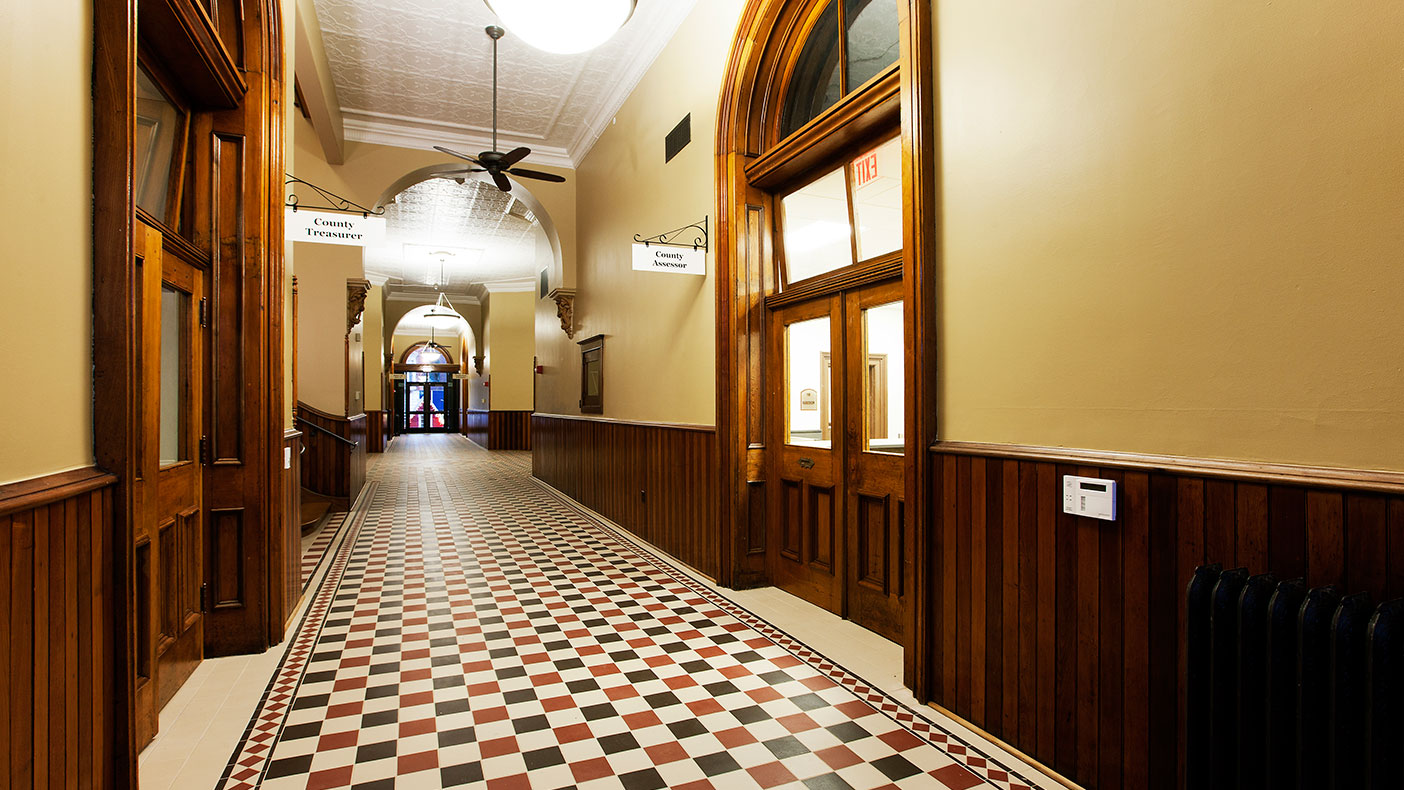 First floor improvements included new ceramic tile, replacing aluminum doors with the original wood doors that were found in a nearby barn, and restoring the woodwork to its original finish.