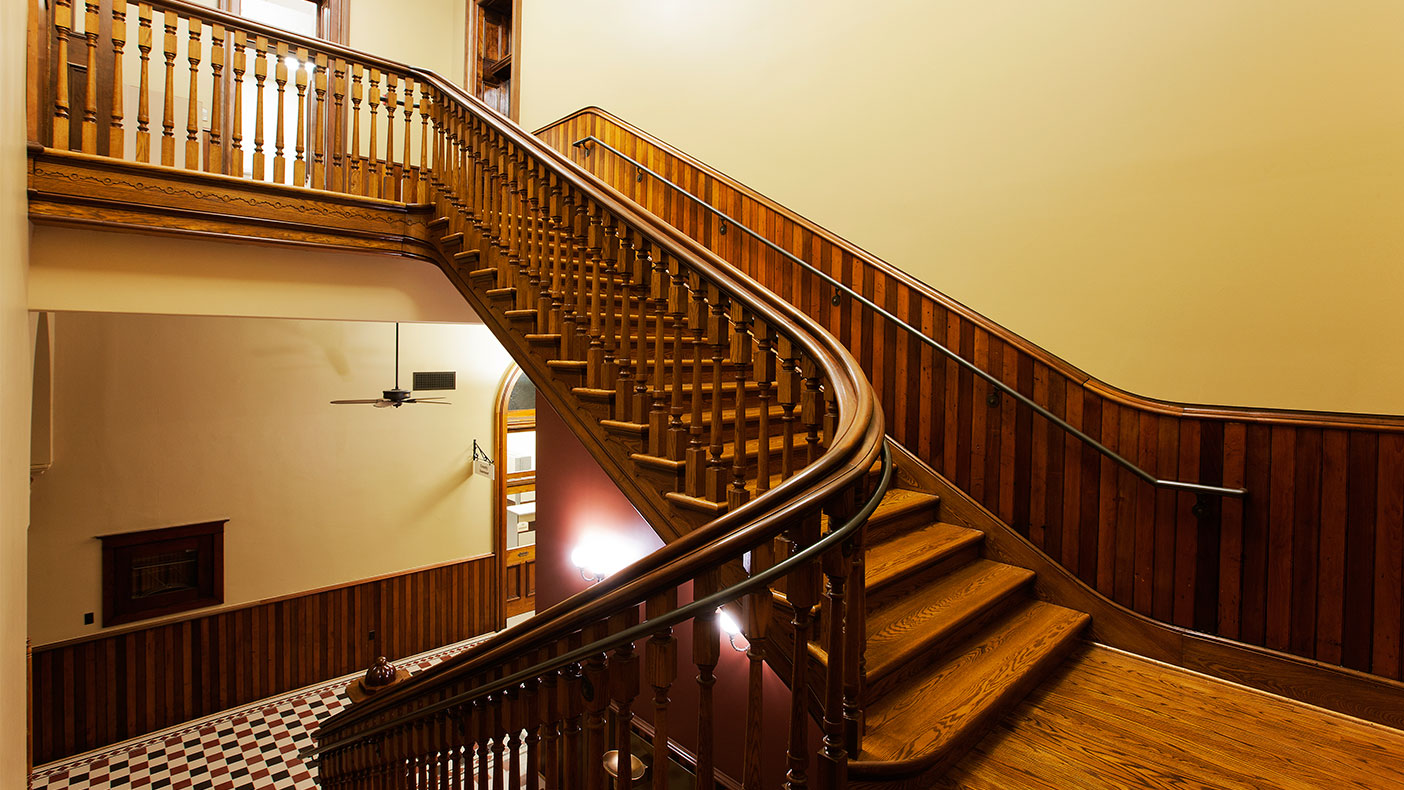 As part of the project, we restored the historic open wood staircases and remodeled the basement for modern office use.