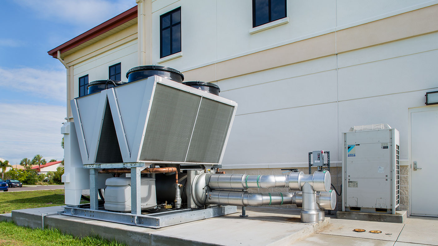 The new 80-ton, magnetic bearing, air-cooled chiller replacement can reach an energy savings estimate of 10 to 20 percent over original baseline building cooling energy usage and cost.