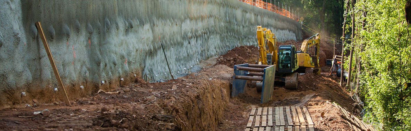 Set on a severe slope, the project required the design and construction of a major retaining wall to allow for safe excavation, protection to a major gas line, and upgradient roadway and railroad.