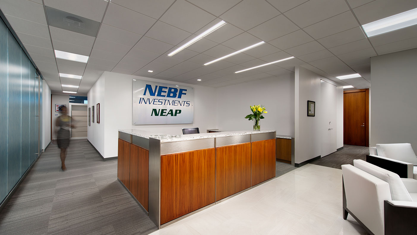 The reception area highlighted NEBF Investments' corporate identity as it welcomes visitors with its modern design.