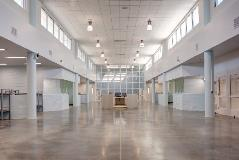 The 43,000-square-foot expansion addresses overcrowding issues and better serves inmates with mental health needs.