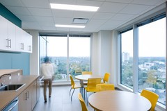 Floor To Ceiling Windows Surround The Walls Of The Single Floor Office,