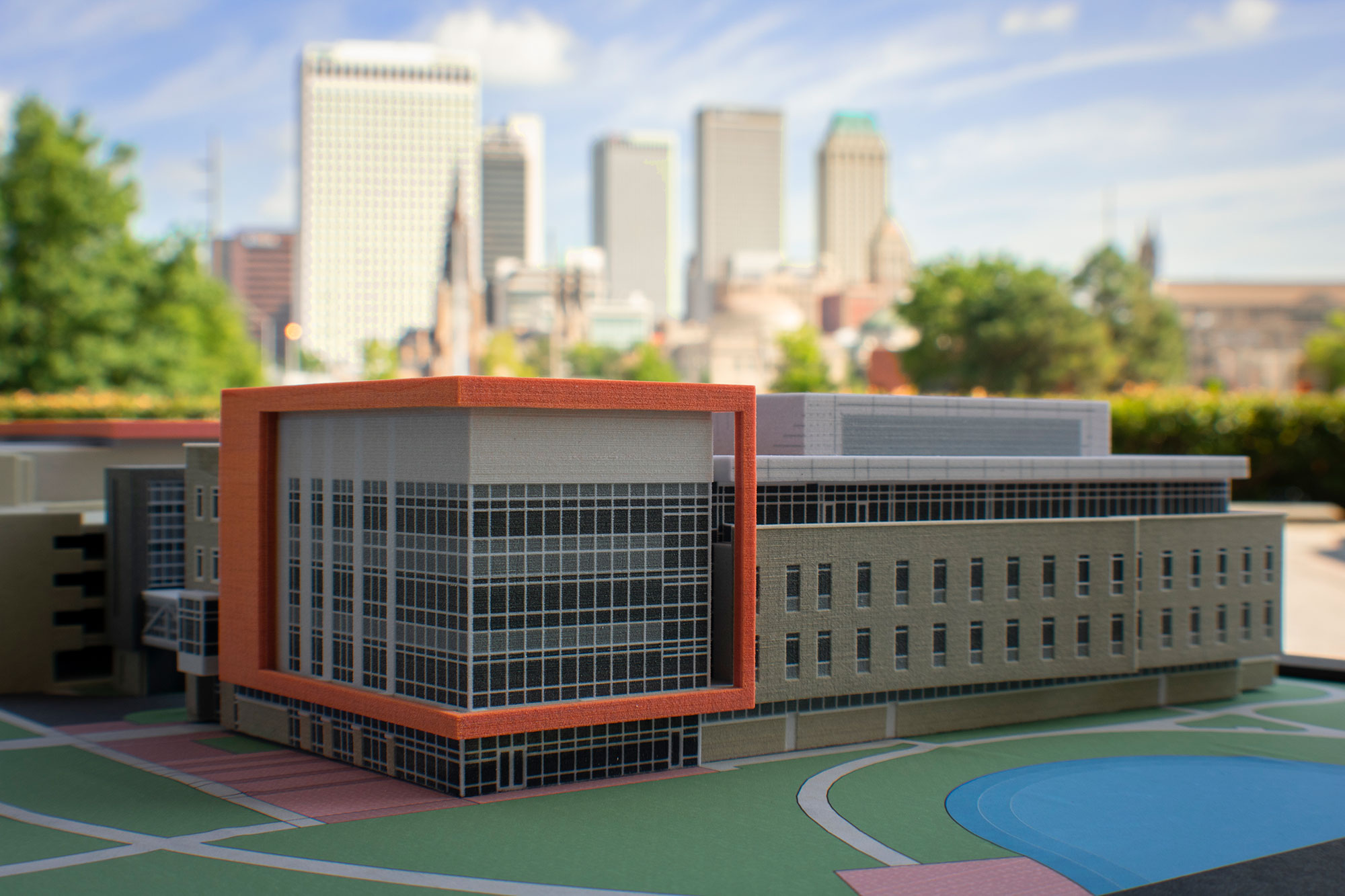 A model of the new building provides a 3D visualization.