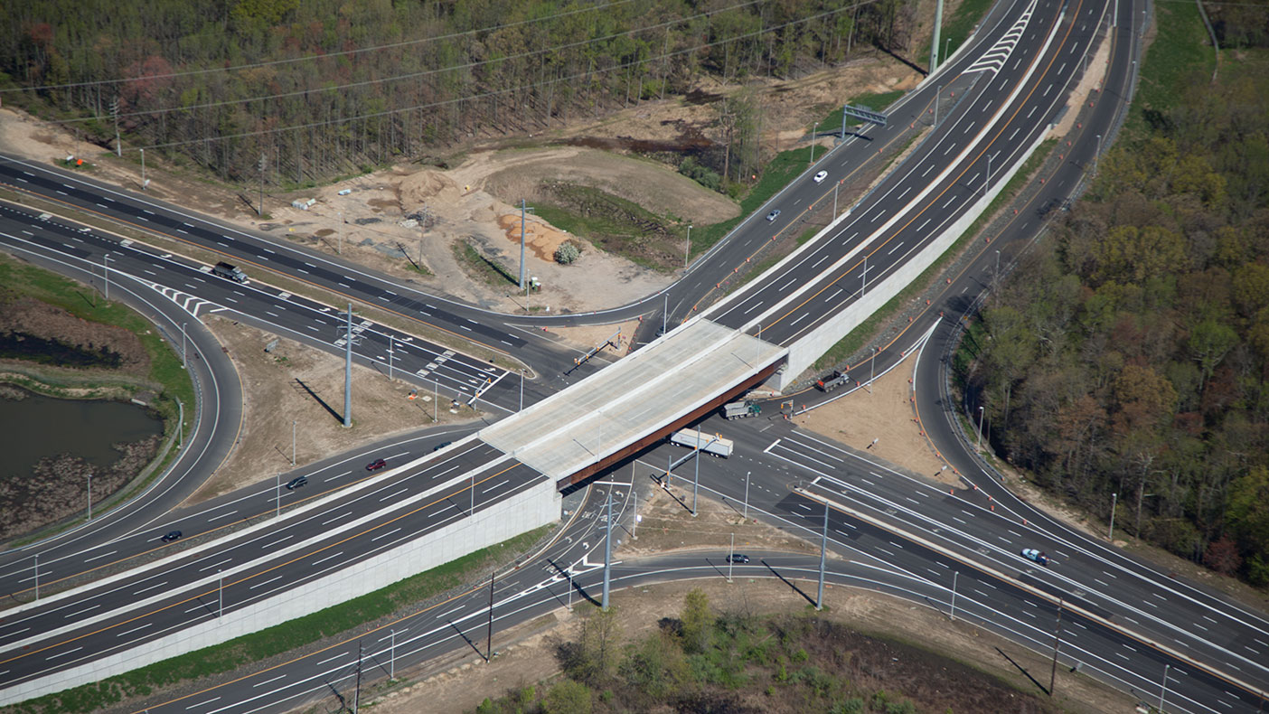 Our designers were challenged to design four two-span curved structures and a 257-foot, single-span curved bridge that accommodated New Jersey's first single point urban interchange (SPUI).
