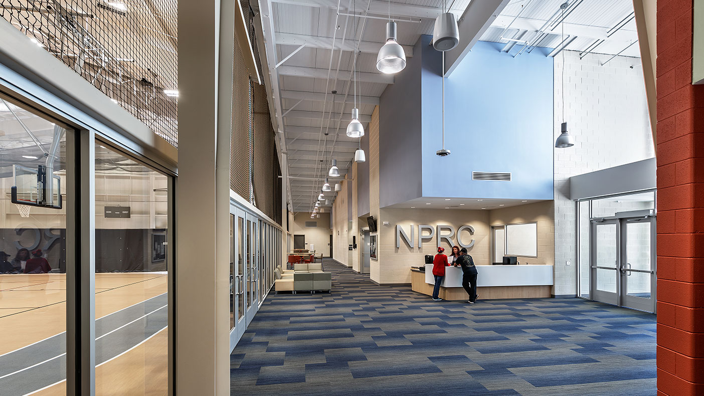 The space provides ample viewing areas, restrooms, and multipurpose spaces adjacent to the control desk at the entrance.