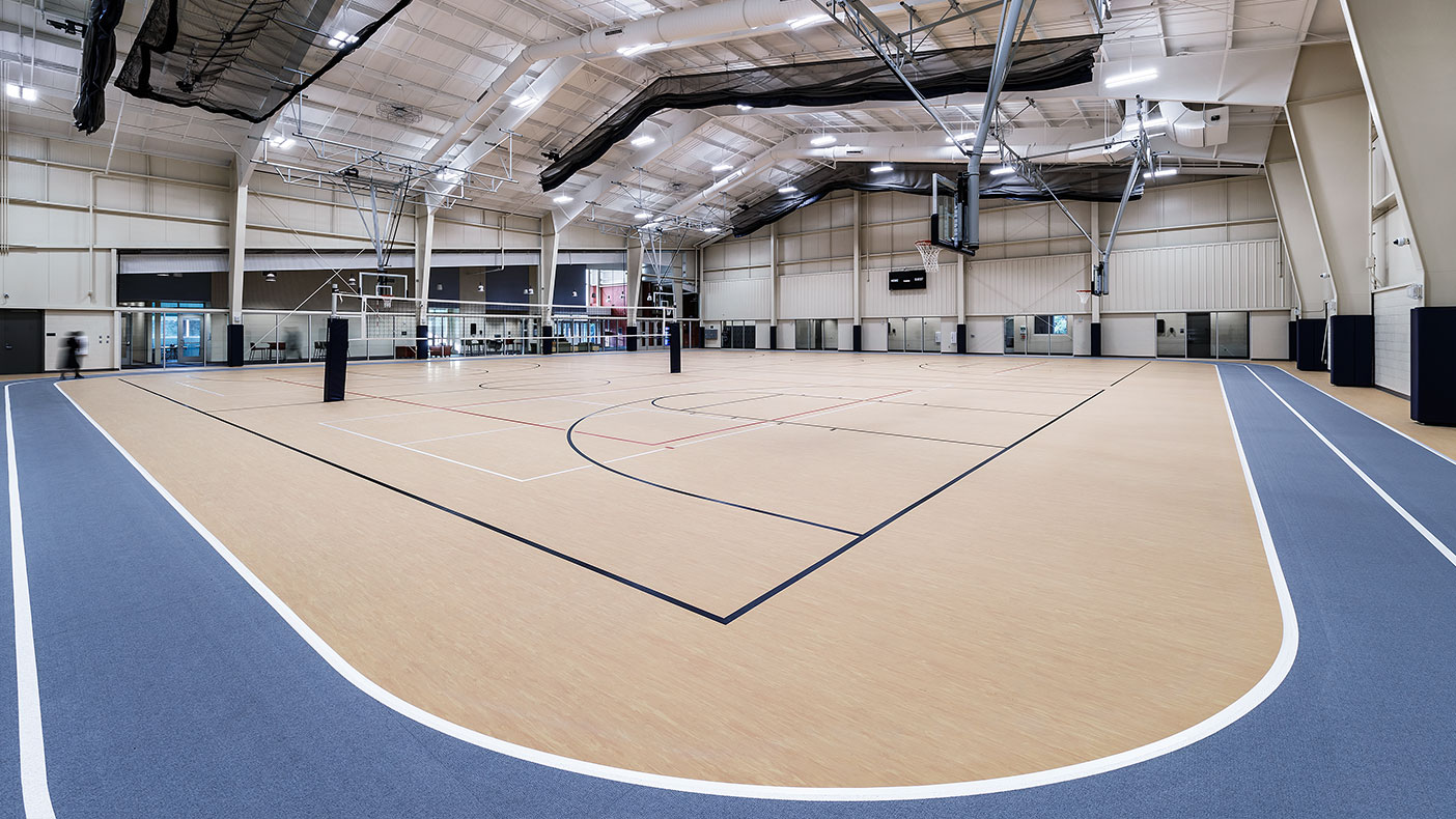 The fieldhouse incorporates a suspended batting cage and divider curtains along with the ability to add another basketball/volleyball court in the future.