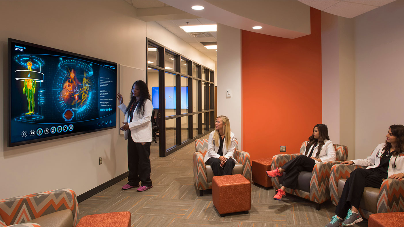 Student support areas, such as this stand up conferencing space, are designed as technology enriched teaching and learning spaces that enhance group dynamics.