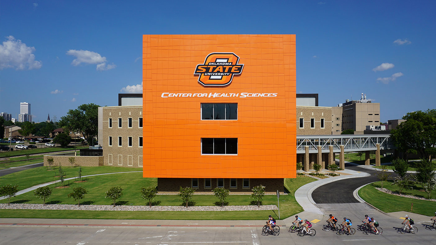 The four-story exterior features a bright-orange skin designed to help OSU-CHS establish its presence and brand along US-75.