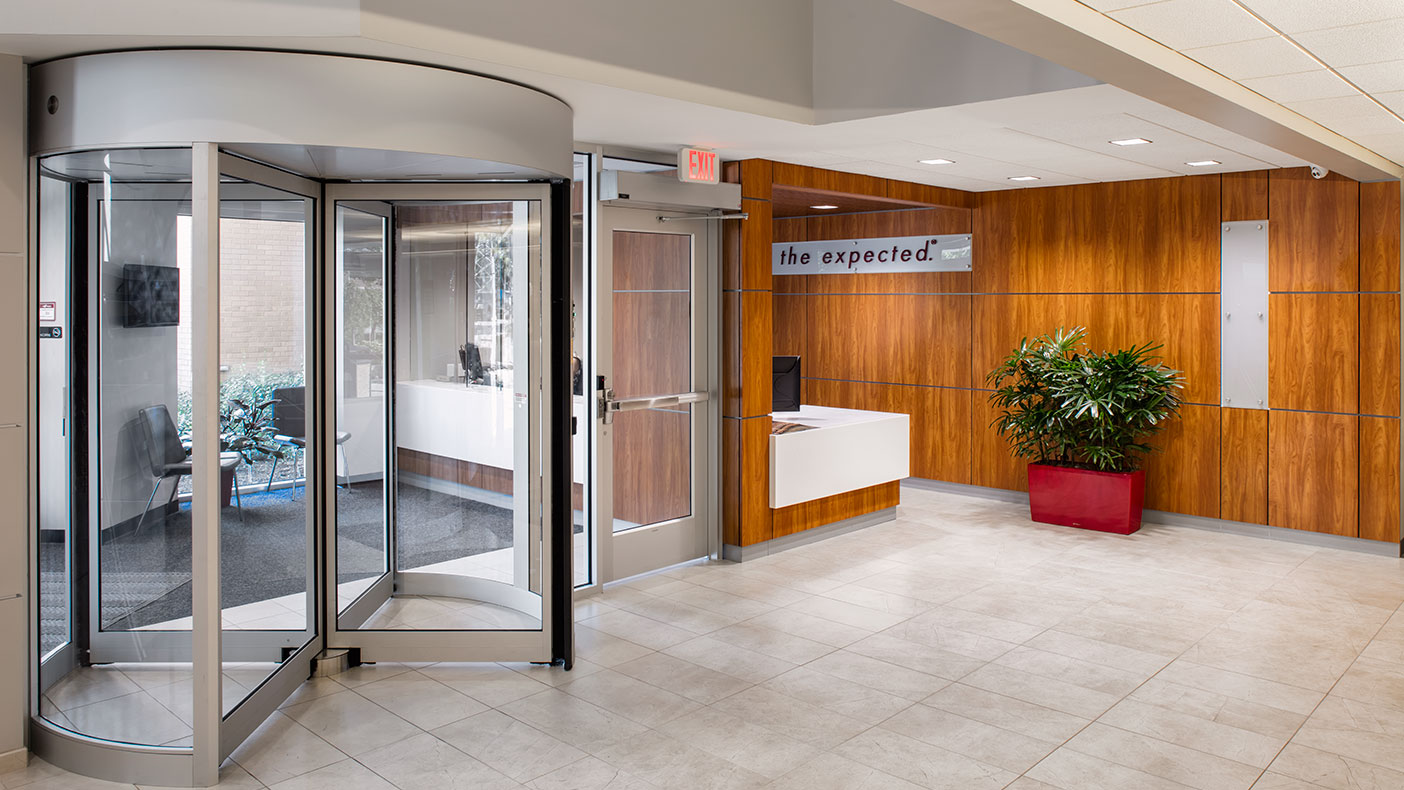 The updated main entrance features a revolving door, openings that allow daylighting, and an improved flow of public interaction.