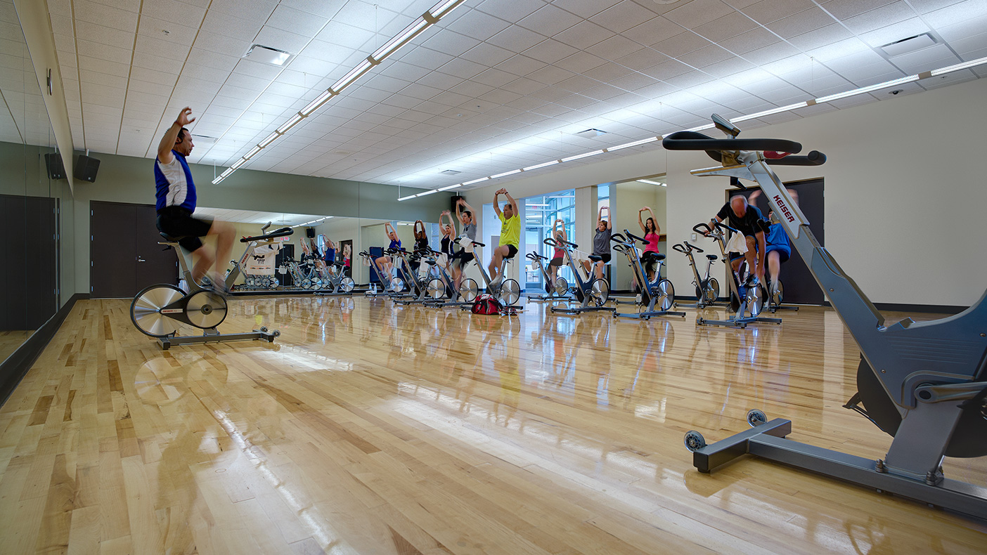 The main level features a 2,275-square-foot exercise studio with a floating wood floor system.