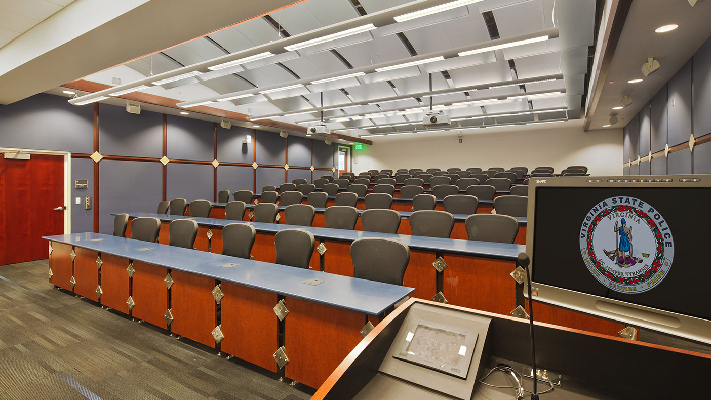 The training building includes 60 squad rooms that accommodate up to 120 cadets, theater-style classrooms, a cafeteria, offices, and meeting space.