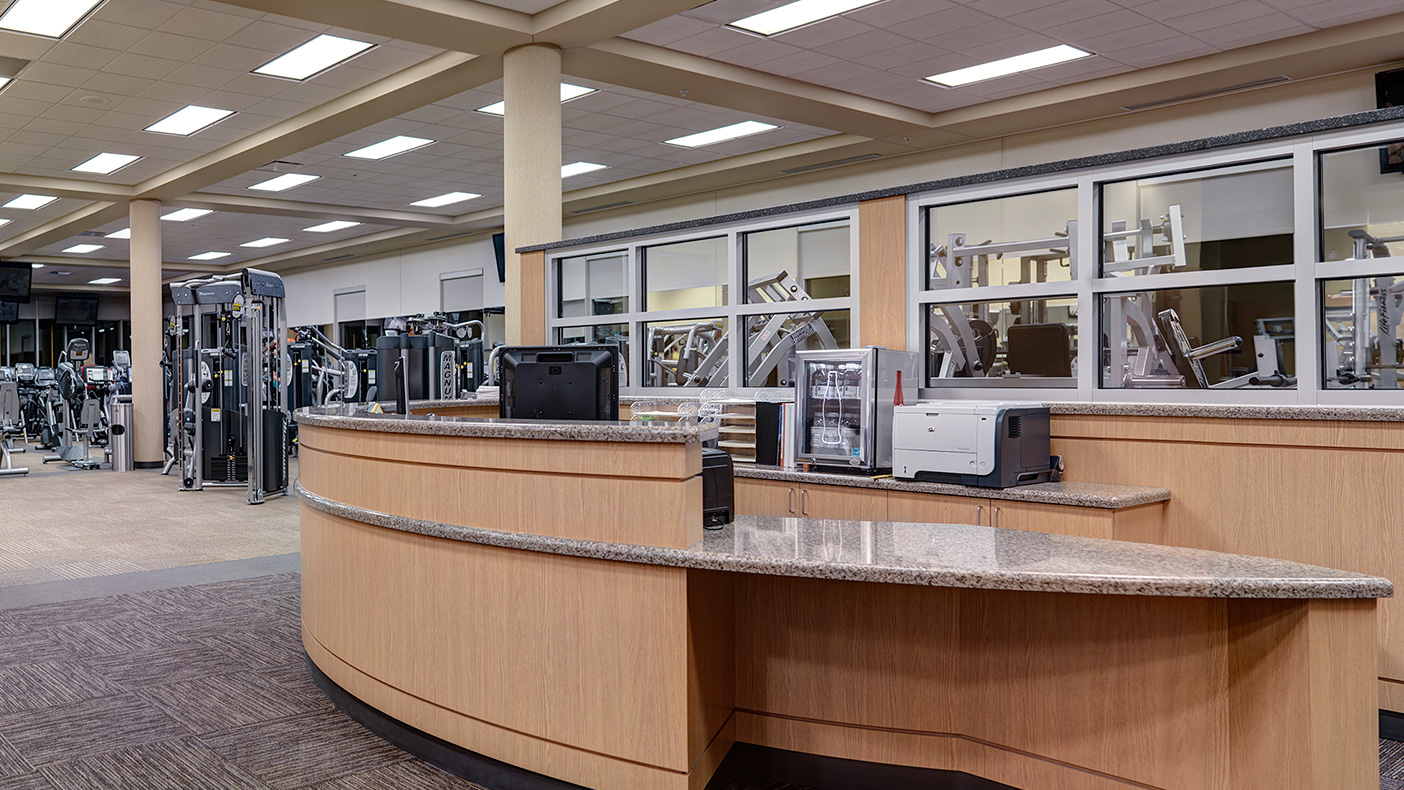 Program space on the main level includes a 5,500-square-foot fitness center, as well as locker and shower areas.