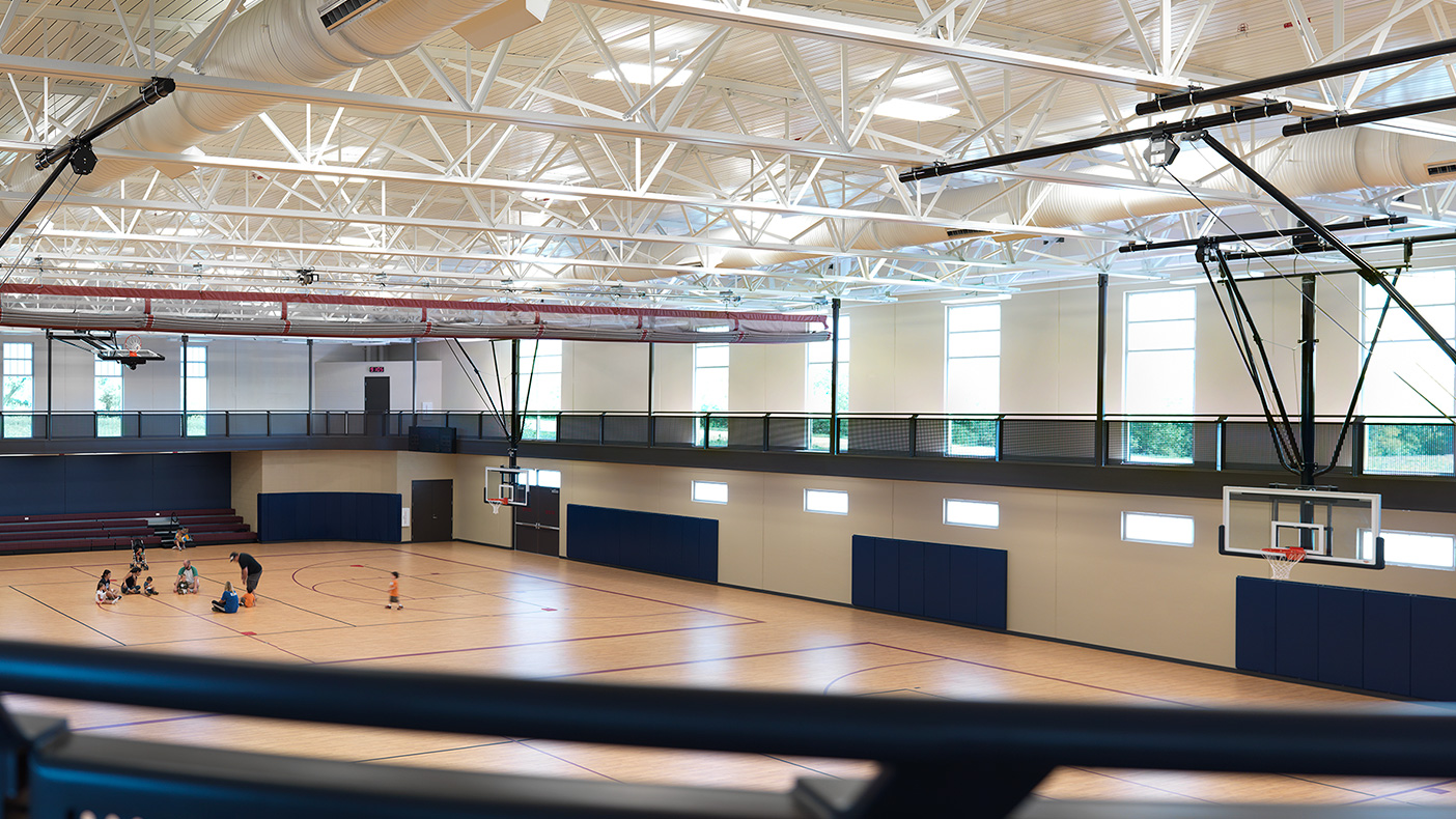 The lower level houses two basketball courts with a suspended perimeter, three-lane walking/jogging track; multi-purpose rooms; and a 5,000-square-foot branch library which will be converted to park district program space after five years.