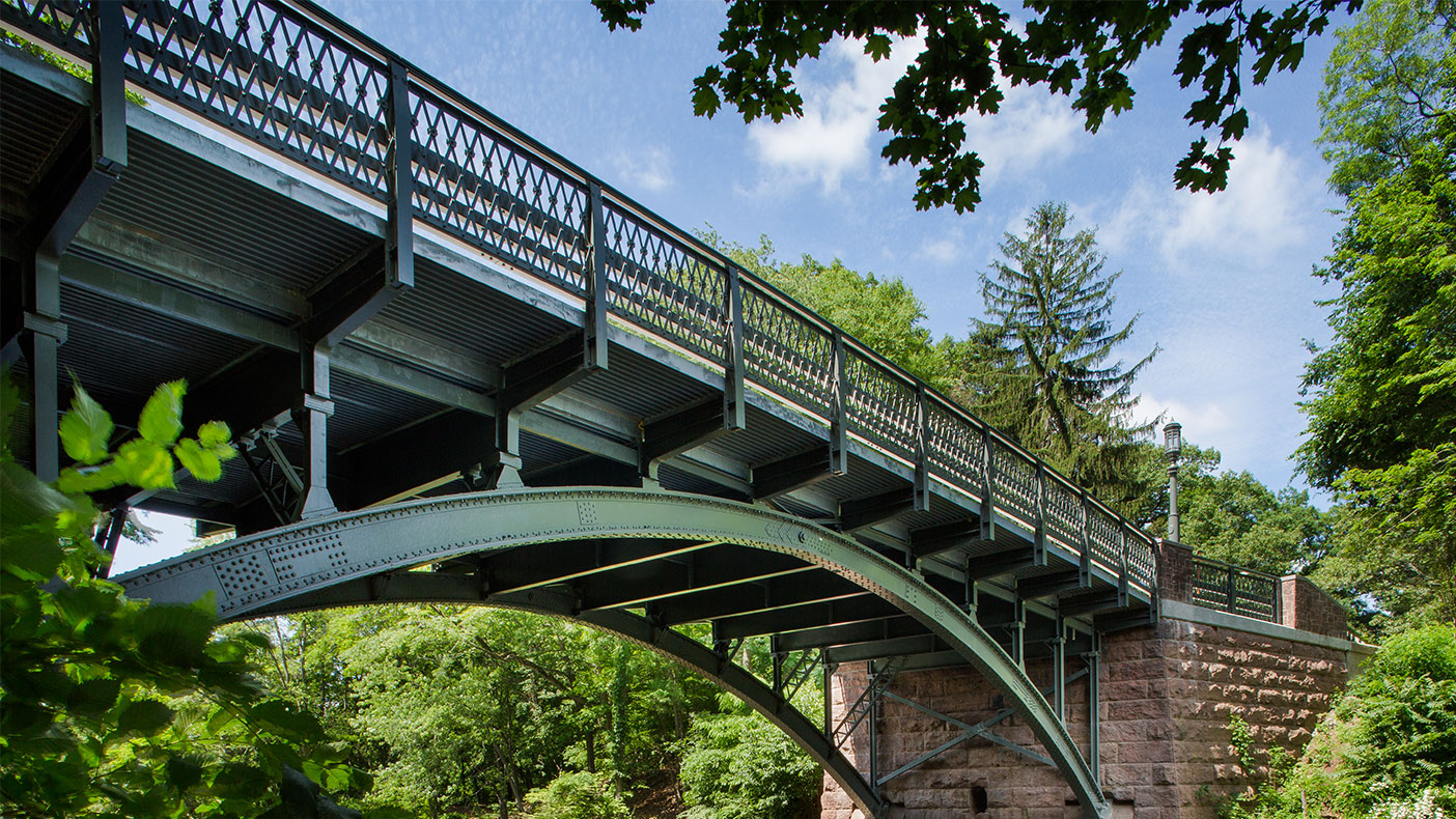 The bridge's 112-year-old arches were originally constructed around 1900 and the bridge holds significant historic importance to the community.