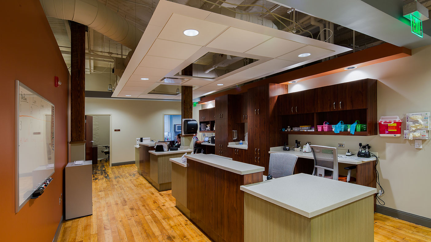 The interior spaces highlight the existing factory setting while providing contemporary, a state-of-the-art office environment for the myriad clinics, physical therapy, and rehabilitation treatment areas.