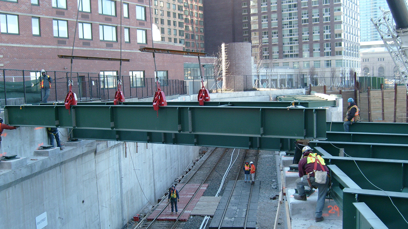 Construction at the West 61st Street Bridge involved daily coordination with Amtrak to schedule flagmen during the days and night-time track outages with track monitoring and protection.